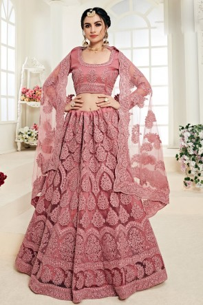 Rust Net Fabric Embroidered And Zari Work Lehenga Choli And Dupatta