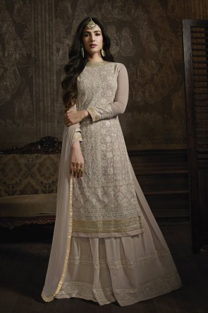 Sonal Chauhan Georgette Designer Beige Embroidered Plazzo Suit With Nazmin Dupatta